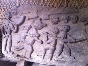 We stopped at a hut that the villagers were working on.  The hut had lots of carvings depicting headhunting and opium smoking.