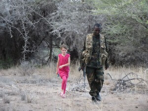 Zoe returns from inspecting a jackal's kill (a gerenuk) with our armed guard.