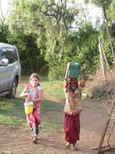 The children invited Zoe to help them do her chores. Here she is fetching water.
