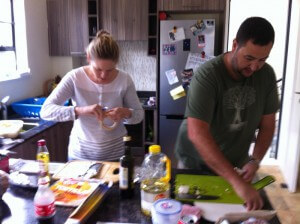 Chris and Liz hard at work preparing camping food.
