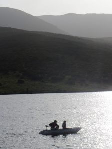 Maciej and Zoe fishing on Lake Ellis.  Maciej brought up his inflatable boat with an electric motor.