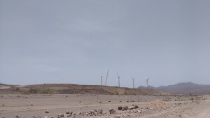 This massive wind farm is being built near the lake.