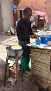 The best street food in Uganda is 'Rolex' - which means 'rolled eggs', but they pronounce and spell 'Rolex'.