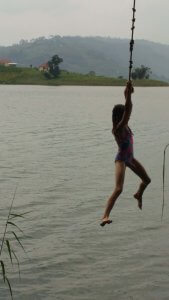 A rope swing in Lake Bunyoni in Uganda.